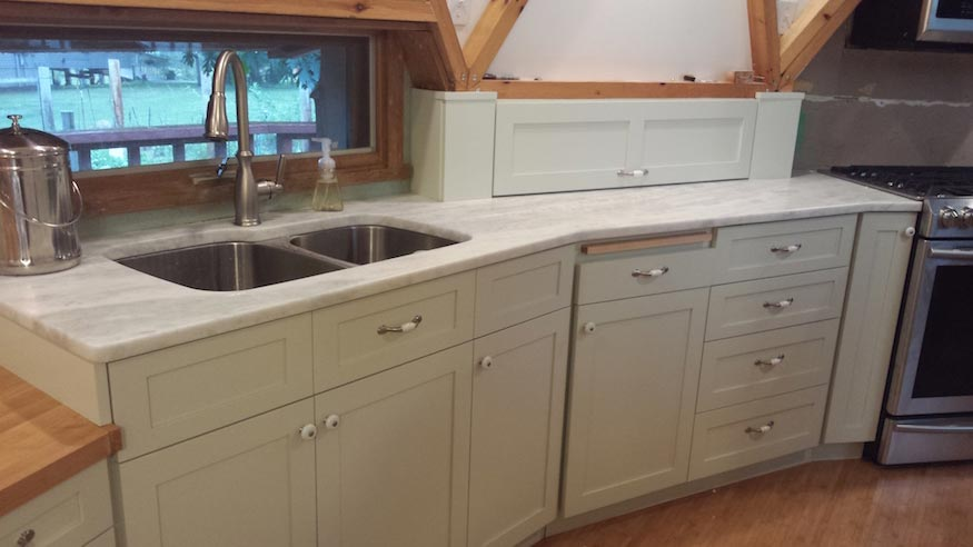 A finished custom set of kitchen cabinets.