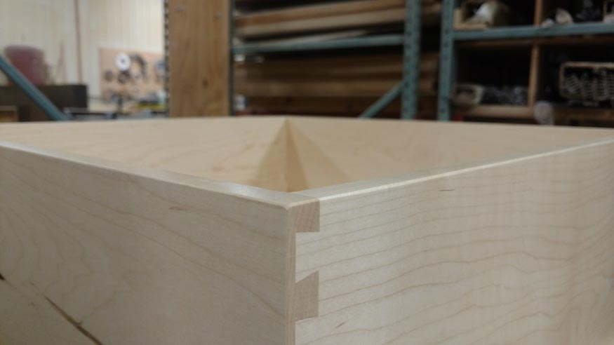 A detail of a dovetail joint one one of our drawer boxes.