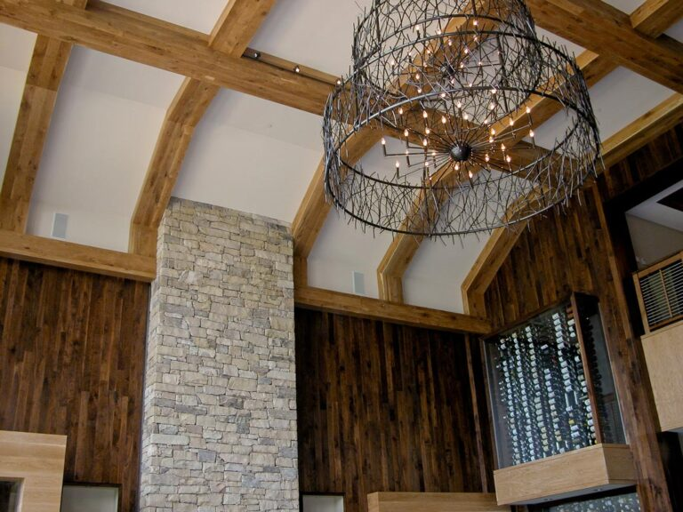 View of the custom paneled walls and ceiling beams at Primland